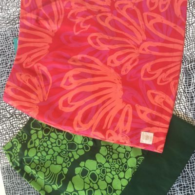 Merrepen Arts printed skirts in red and green.